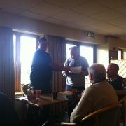 Terry Daly barely acknowledges receiving the horseshoe at Garstang